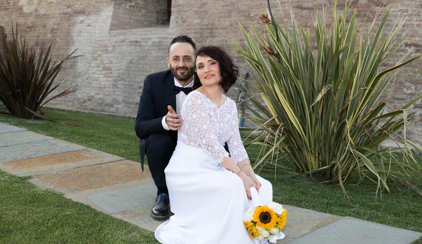 Costo-fotografo-matrimonio-sposi in posa inginocchiati
